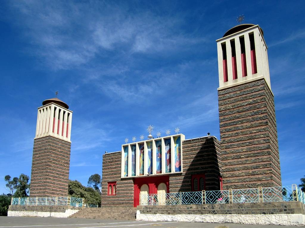 Enda Mariam Orthodox Cathedral (1938) stands on the original site of the Four Villages (Arbate Asmere) which gave Asmara its name.